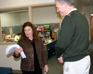 Executive Director, Lisa Arkin, delivers nearly 12,000 signatures of Oregonians who want to save our bees to ODA's Bruce Pokarney, Director of Communications.