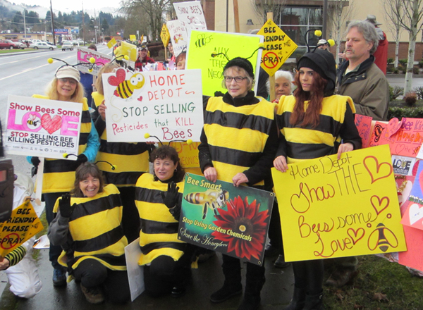 Several bee-costumed ralliers posed for the news camera.