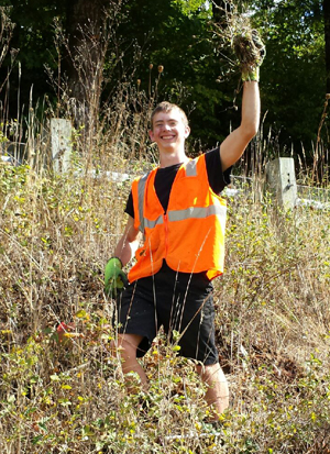 Isiah holds up Knapweed during his first Weed Pull adventure!