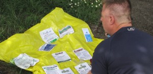 Darryl Ivy on the phone with Oregon OSHA (Occupational Safety and Health) reviewing labels of the chemicals used on his job site while working for Applebee Aviation in Douglas County.