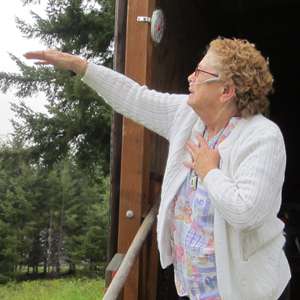Cedar Valley resident points to the path of the helicopter that sprayed her home.
